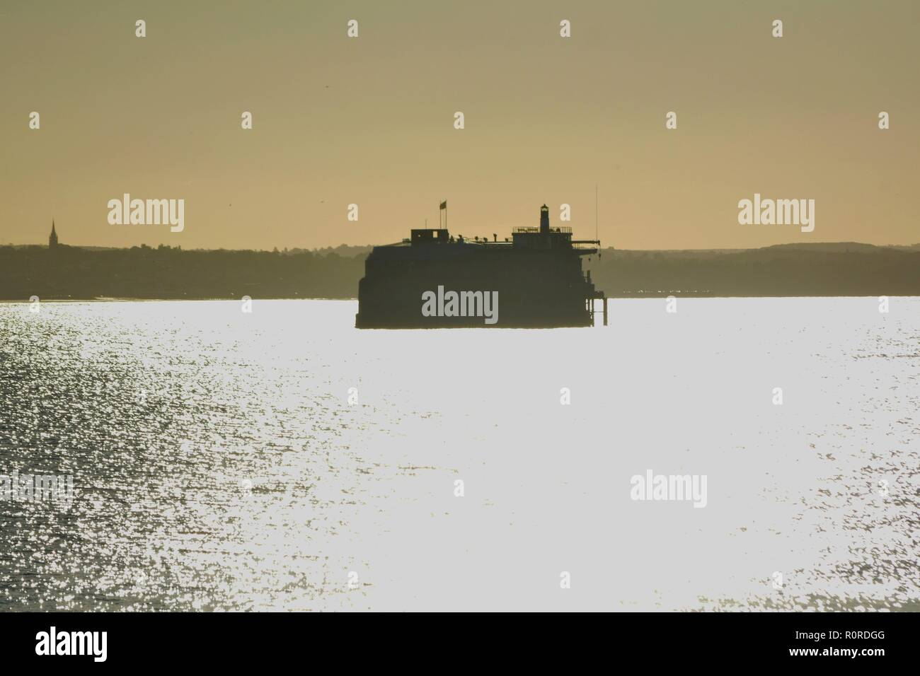 Spitbank  sea fort in the solent isel of wight in the background with sunlight - Stock Image