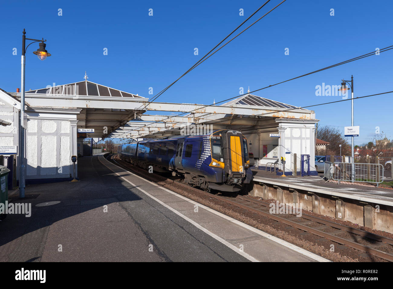 A Scotrail class 380 electric train at Troon railway station on the Ayrshire coast railway line - Stock Image