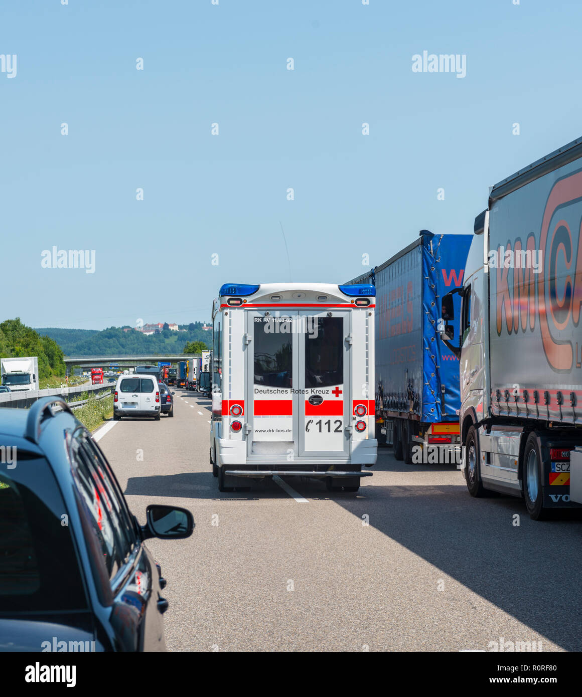 Ambulance drives through rescue lane, traffic jam on motorway, Bavaria, Germany - Stock Image