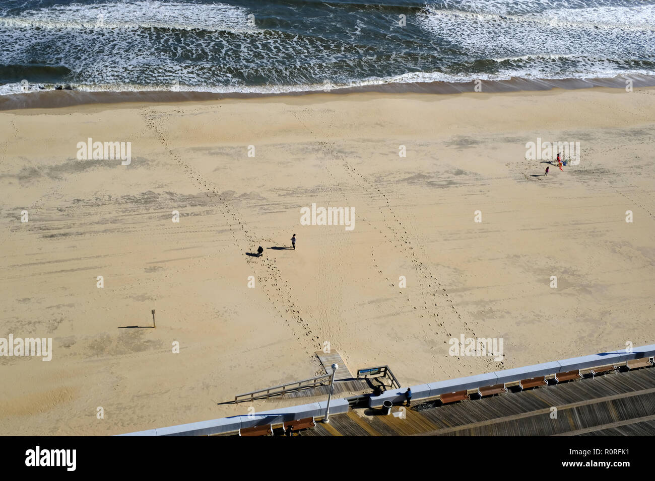People on the beach at a distance in Ocean City, Maryland - Stock Image