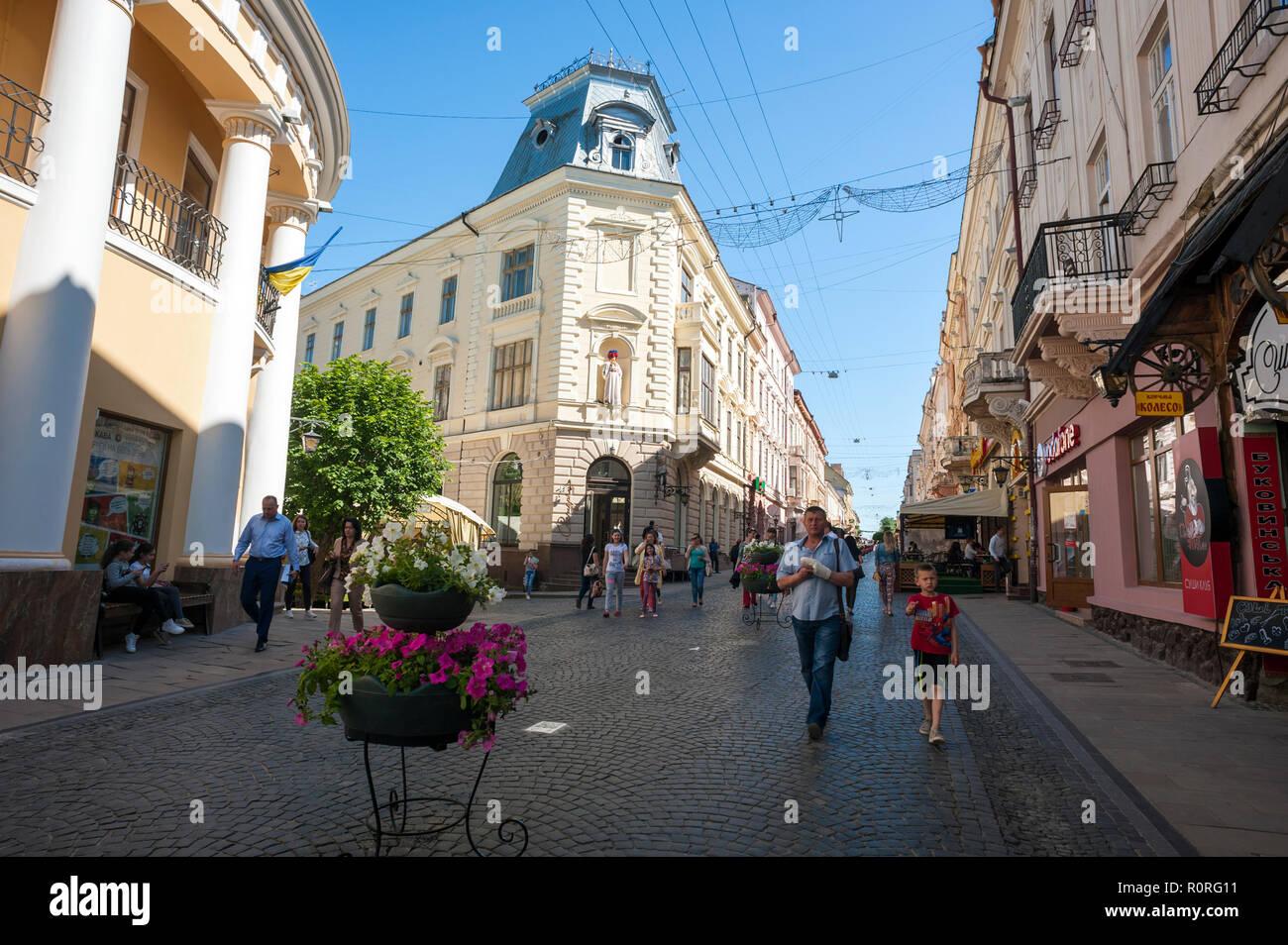 Pedestrians on Olha Kobylyahska Street in Chernivtsi, a superb example of Austro-Hungarian Empire architecture in western Ukraine. - Stock Image