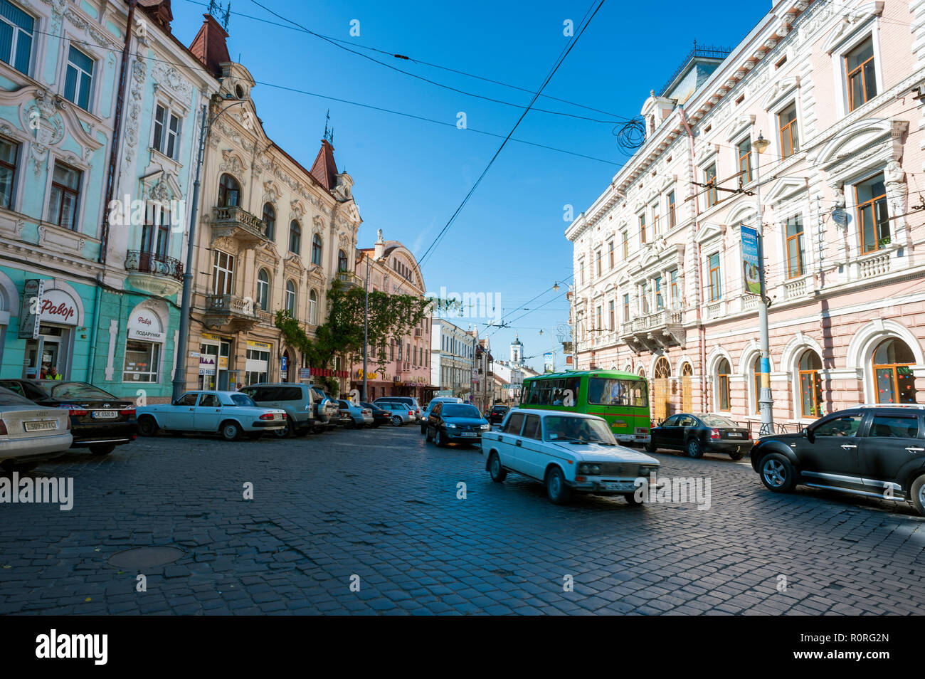 A street scene in Chernivtsi, a superb example of Austro-Hungarian Empire architecture in western Ukraine. - Stock Image