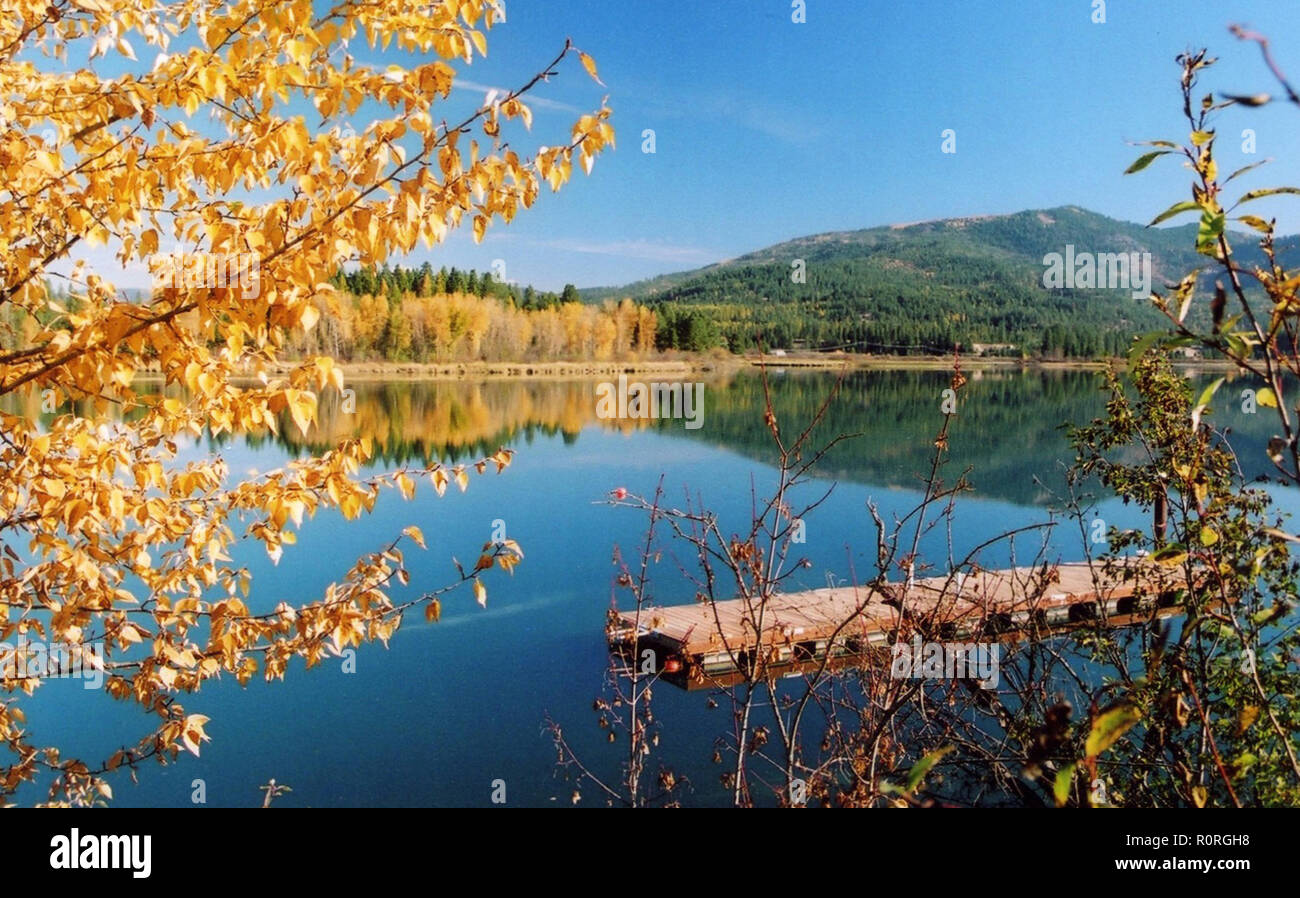 Fall reflections in the Pend Oreille River - Stock Image