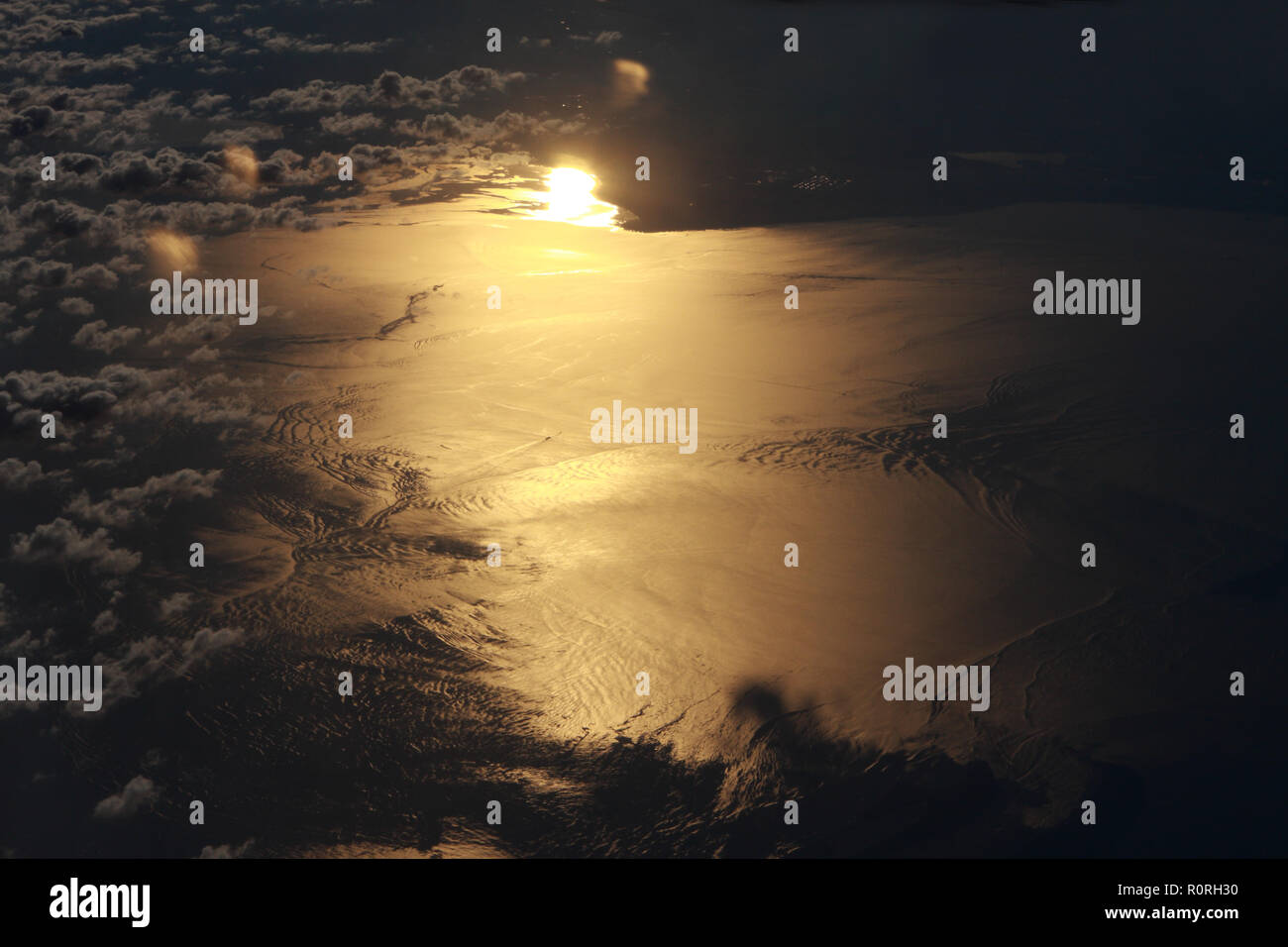 Arial view of Sun reflected on water - Stock Image