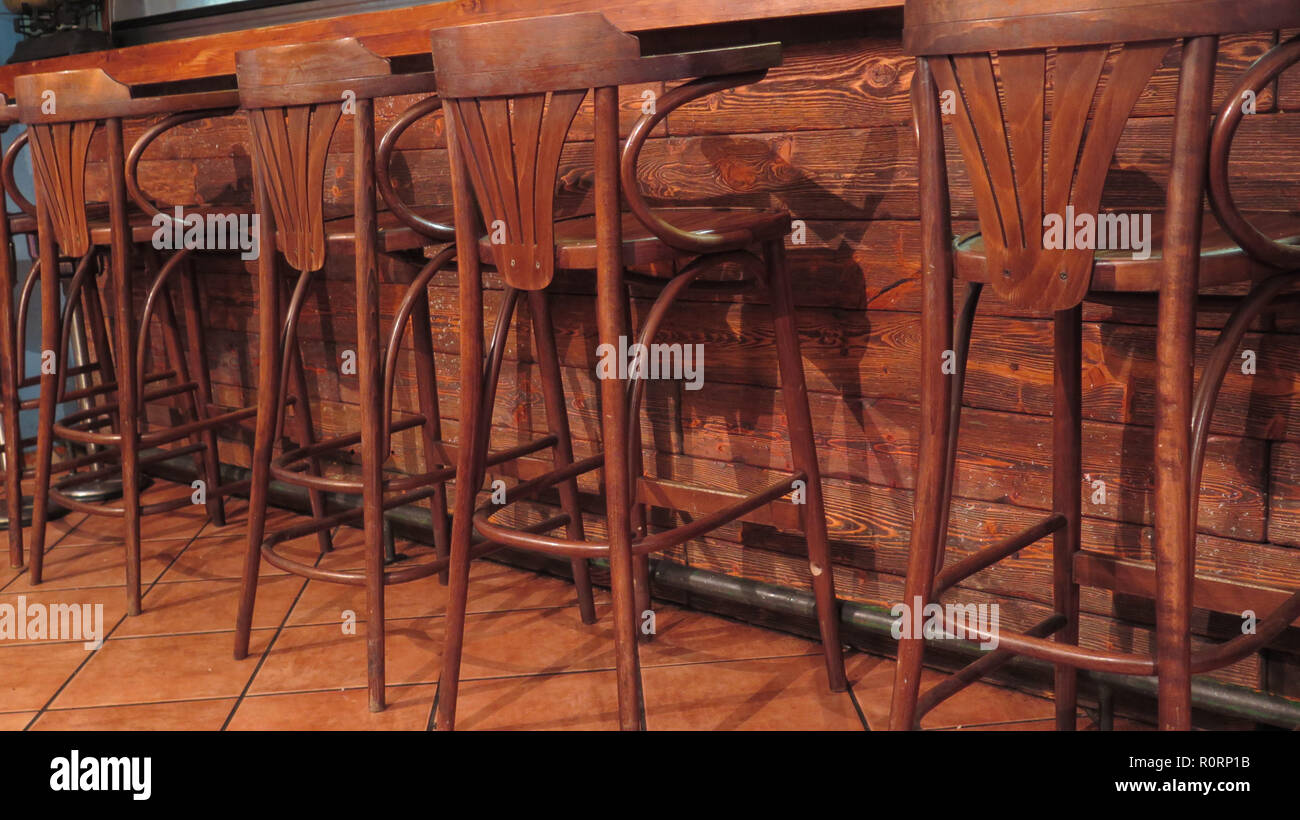 Tremendous Row Of Wooden Bar Stools In Empty Restauant In Granada Evergreenethics Interior Chair Design Evergreenethicsorg