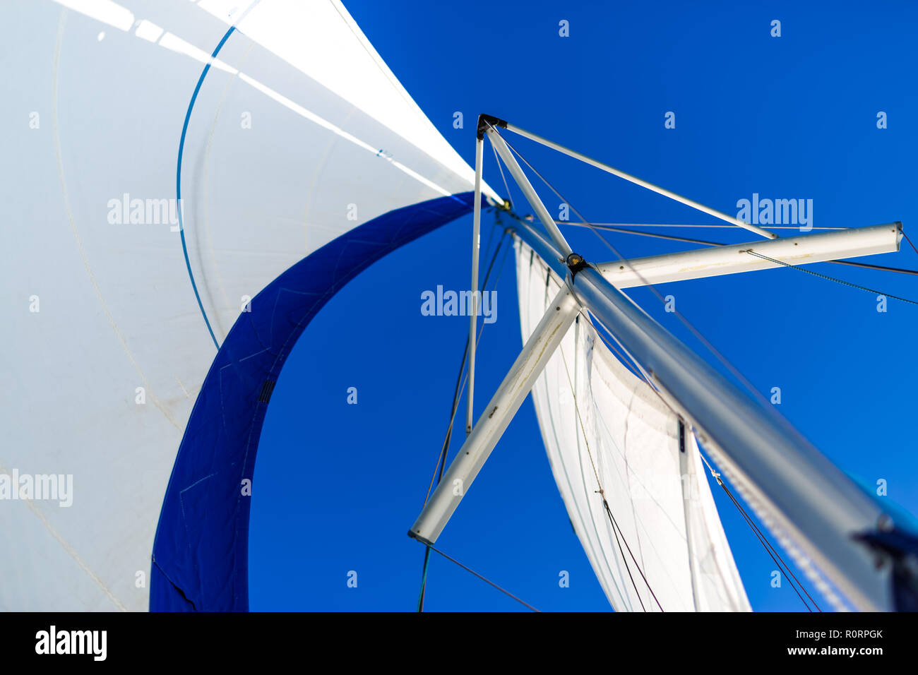 White sails of a sailing yacht in the wind. Recreational water sport - Stock Image