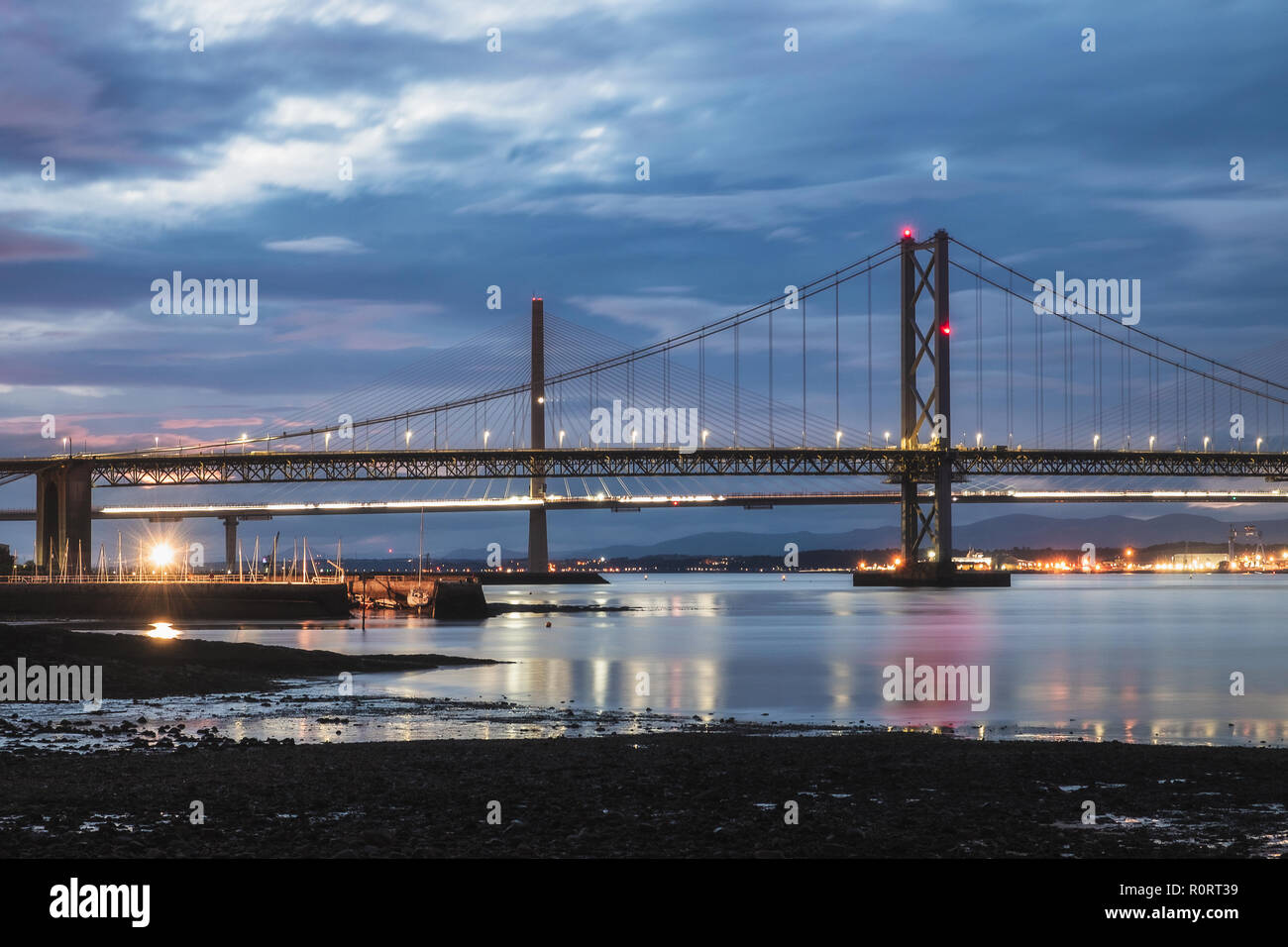Night view on two bridges, Forth Road Bridge and Queensferry Crossing. Scotland, United Kingdom Stock Photo