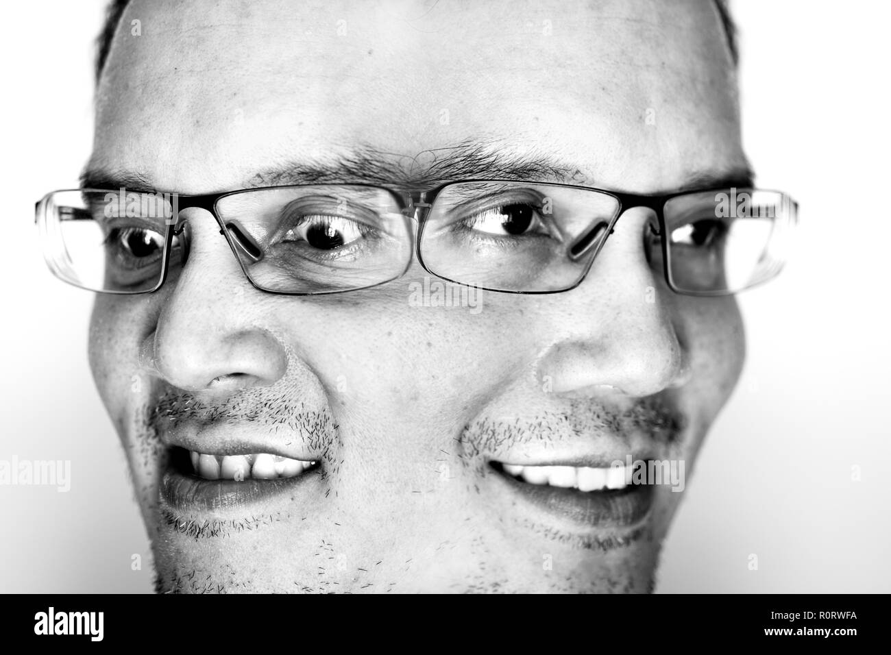 Two emotion face of a man. One is happy with smile, another in angry and mad. - Stock Image