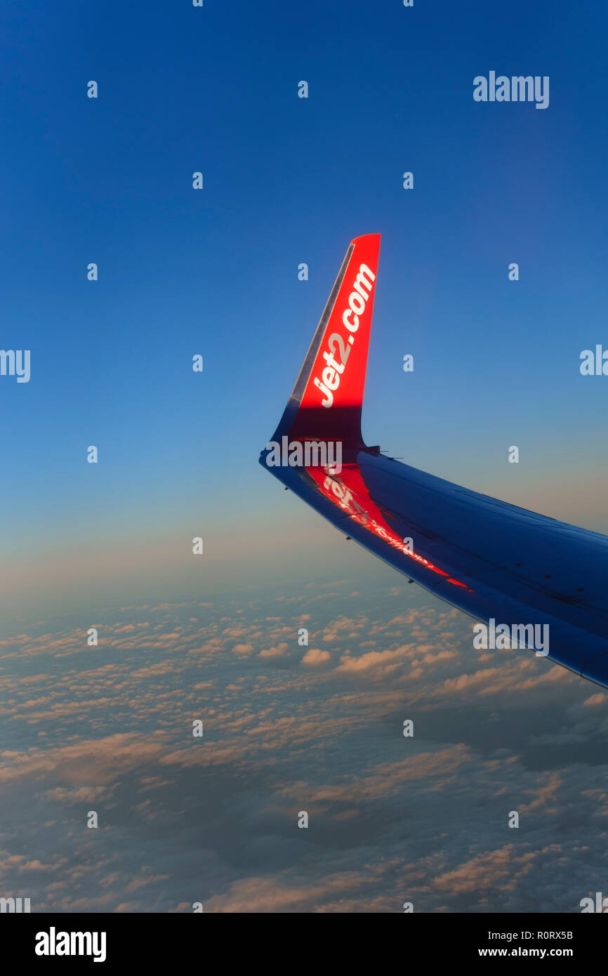 Boeing Jet2.com wing over a cloudscape at 30,000 feet. - Stock Image