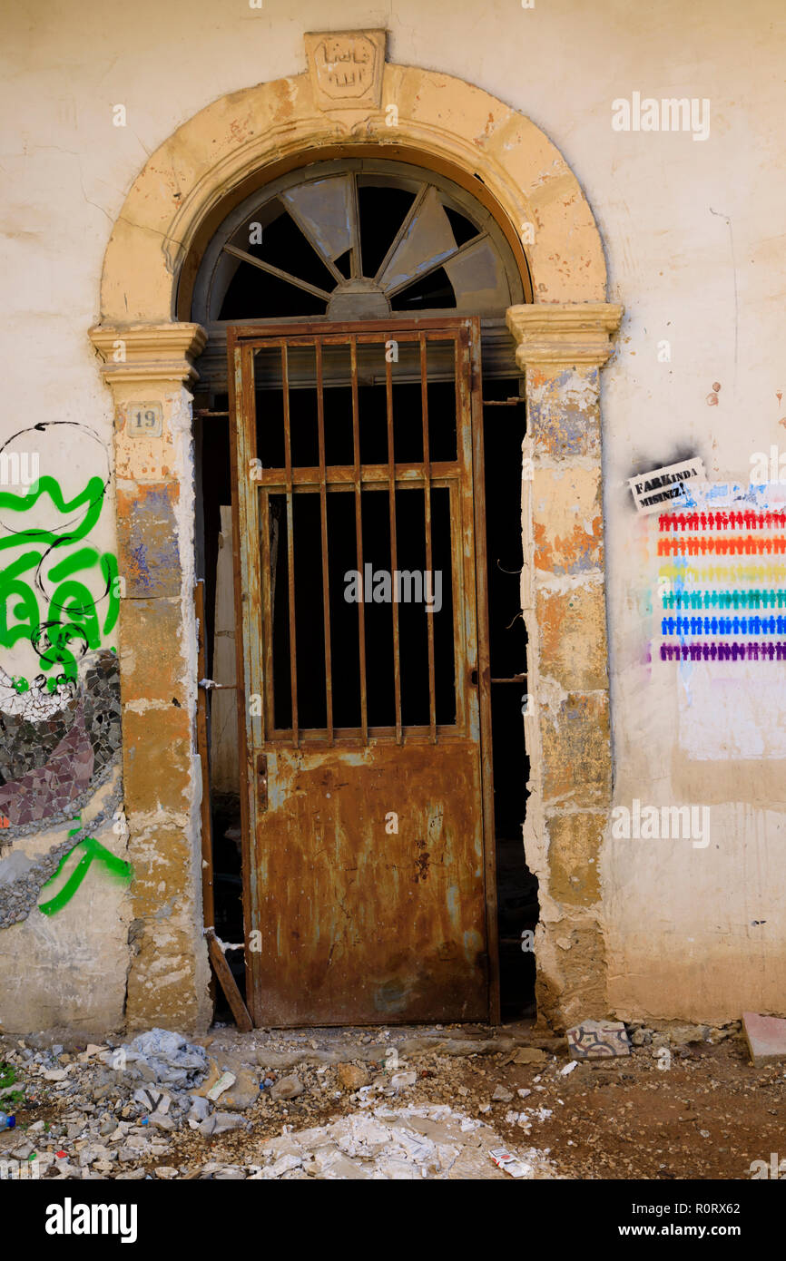 Old doorway with graffiti, North Nicosia, Turkish Northern Cyprus October 2018 - Stock Image
