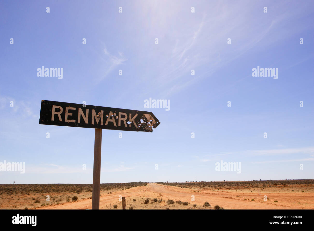 Road Sign with bullet holes, outback NSW, Australia. - Stock Image