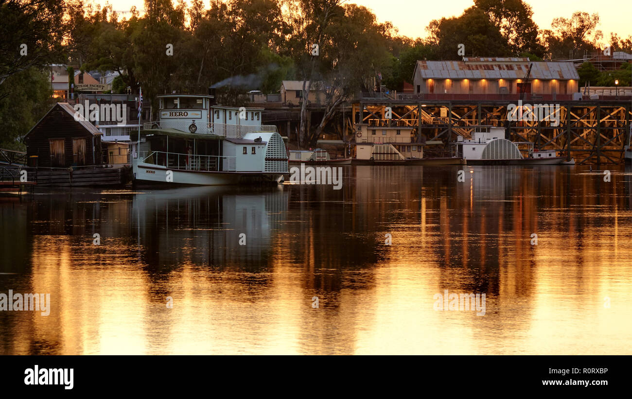 Evening falls over the Echuca Wharf. Paddle boats moored for the night. - Stock Image