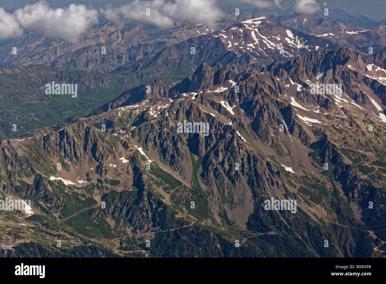Aiguille du Midi, Chamonix, south-east France, Auvergne-Rhône-Alpes. Sunny views across the Chamonix valley at Aiguilles Rouges mountain massive from  - Stock Image