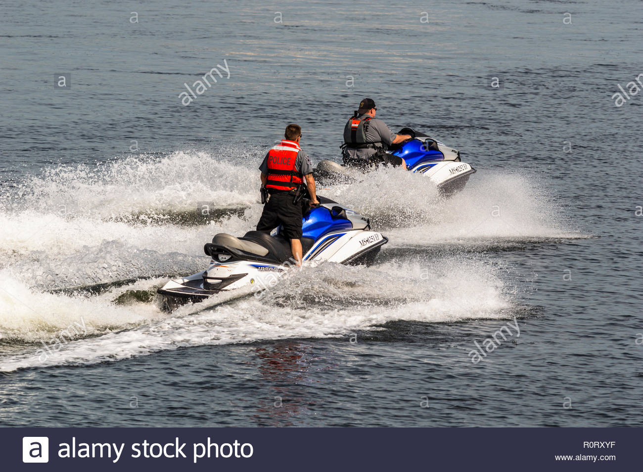 Fairhaven, Massachusetts, USA - June 30, 2018: Police riding personal watercraft crossing Acushnet River toward Fairhaven waterfront - Stock Image