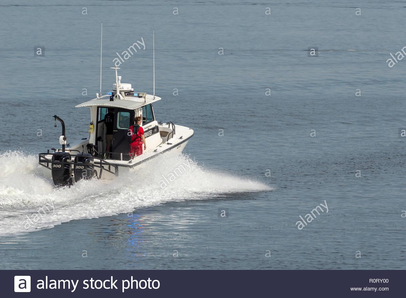 Fairhaven, Massachusetts, USA - June 30, 2018: Fairhaven Harbormaster boat crossing Acushnet River toward Fairhaven waterfront - Stock Image