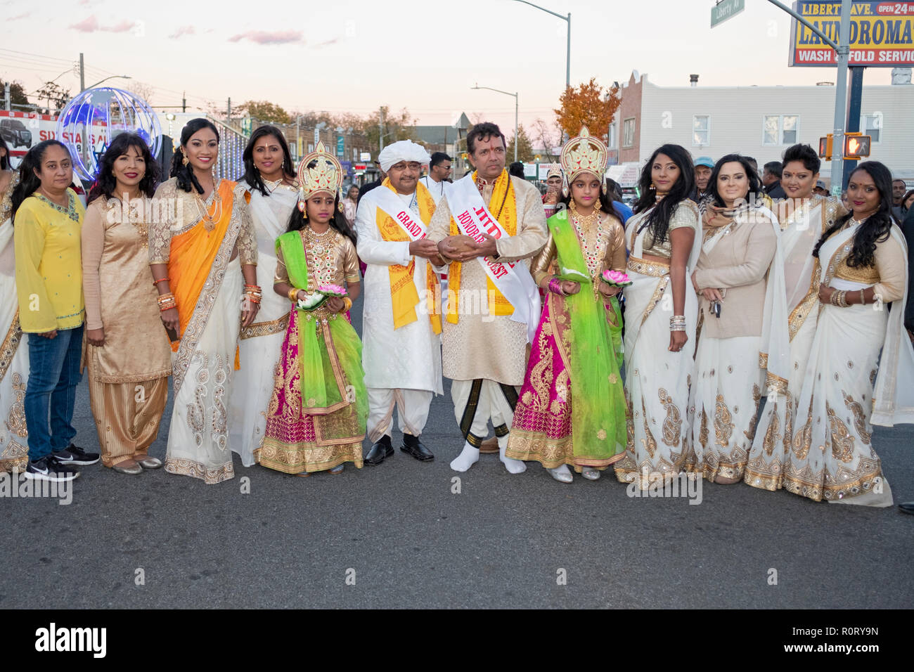 Participants in the Diwali motorcade, many in the same sari, pose with the Grand Marshall & special guest. In South Richmond Hill, Queens, New York. - Stock Image