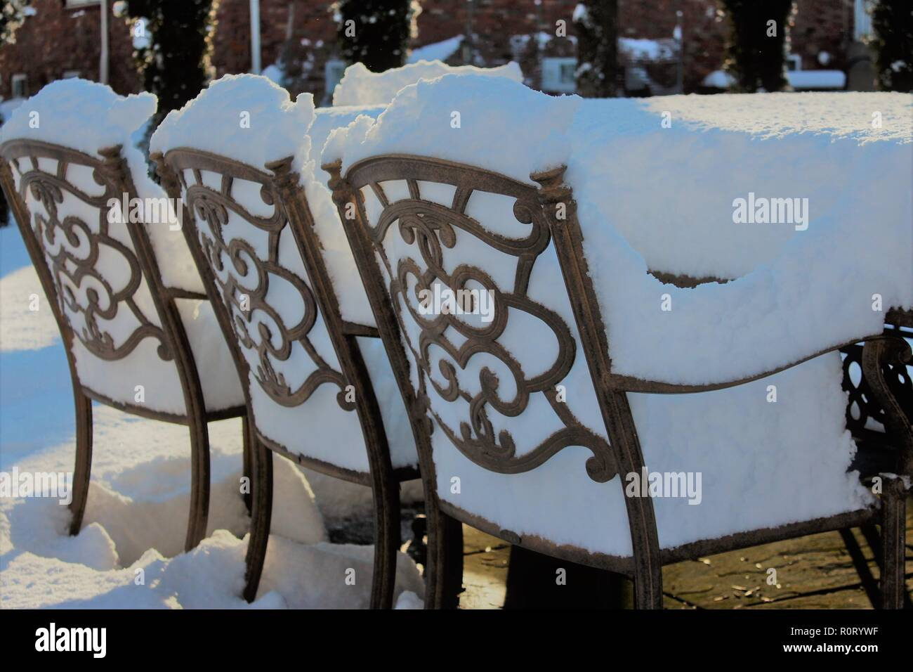 Outdoor furniture filled with snow - Stock Image
