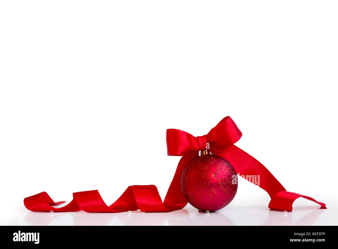 Red christmas ball, with red bow, isolated on white background, with copy space Stock Photo