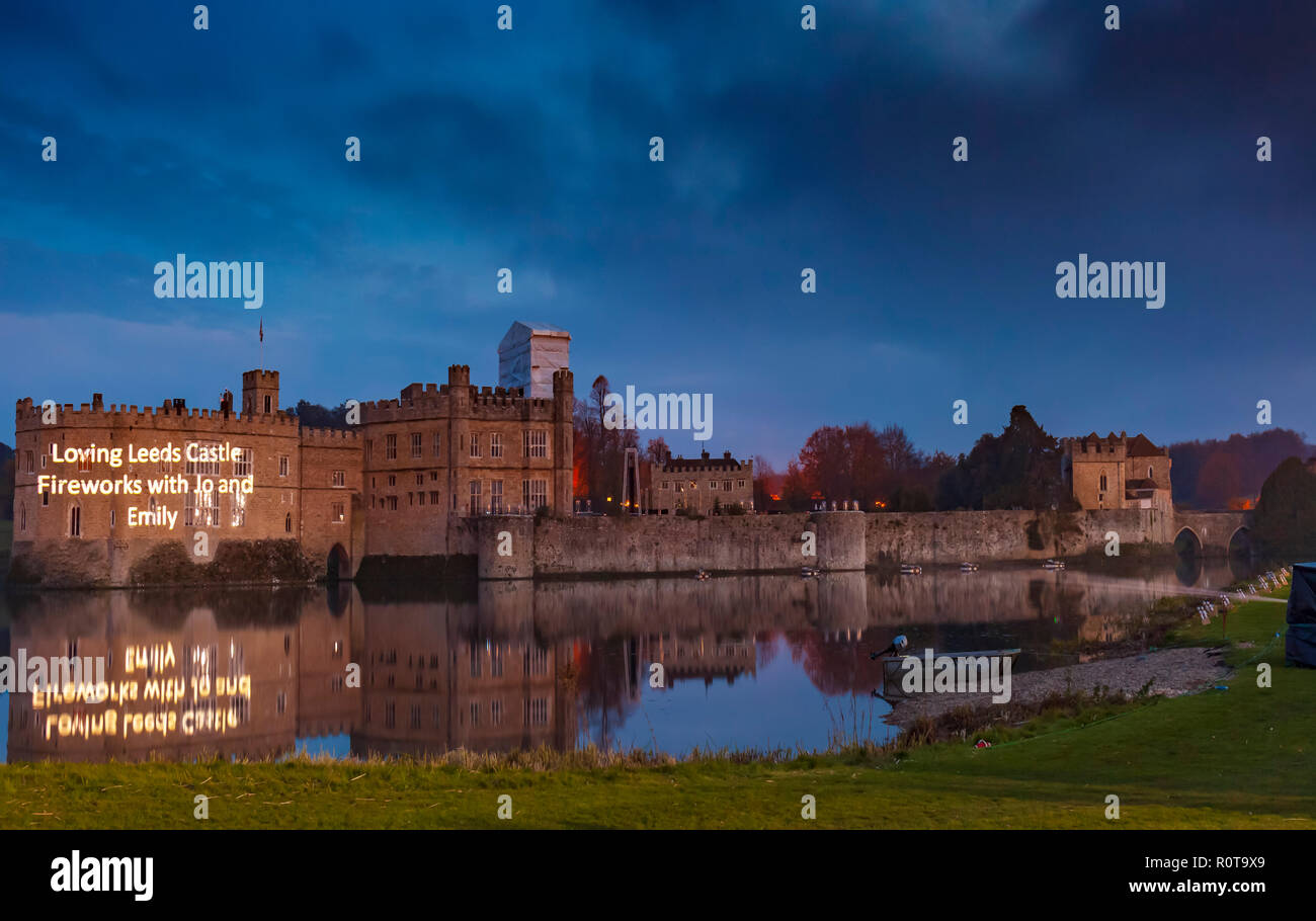 Leeds Castle, Kent, England, UK. 4th November 2018.  Before the firework display personal messages are projected onto the wall. - Stock Image