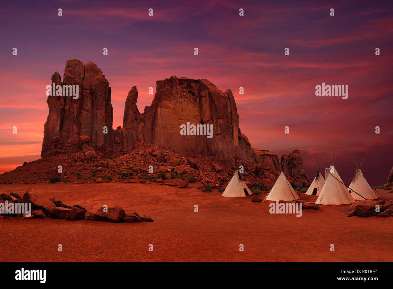 Wigwams/tepees of native Americans in Monument Valley at sunset, Arizona-Utah border, USA - Stock Image