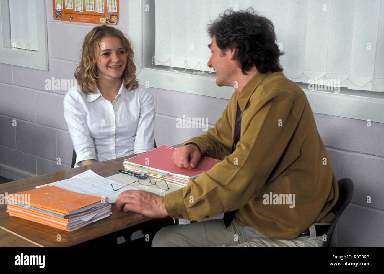teenage student having consultation with teacher - Stock Image