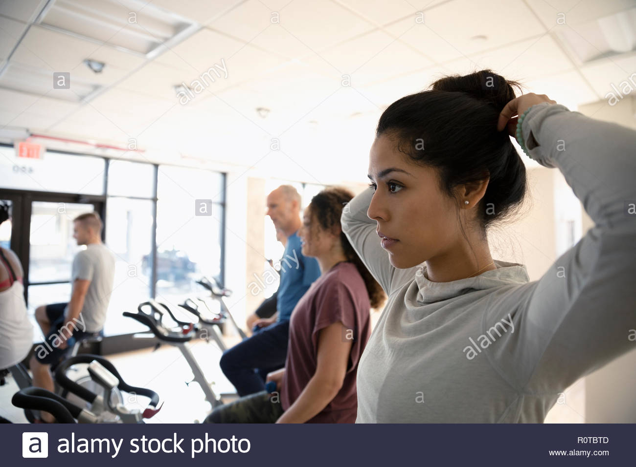 Woman preparing for spin class in gym Stock Photo