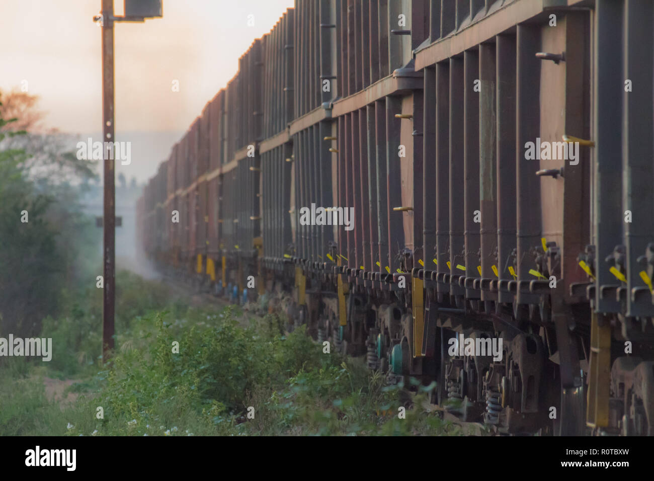 train waggons comming from misty background along railway - Stock Image