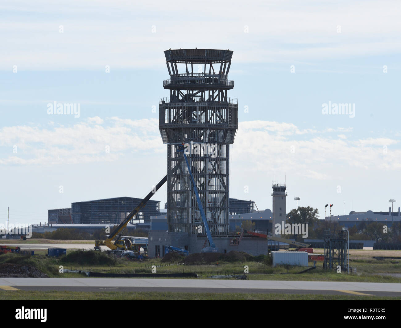 Photo showing the construction progress for the new air traffic control tower (with the old ATC tower visible in the background) Nov. 6, 2018, Tinker Air Force Base, Oklahoma. The new tower will accomodate more controllers and support personnel from a position on the airfield which gives much better overall views of the field and approach/departure corridors. (U.S. Air Force photo/Greg L. Davis) - Stock Image