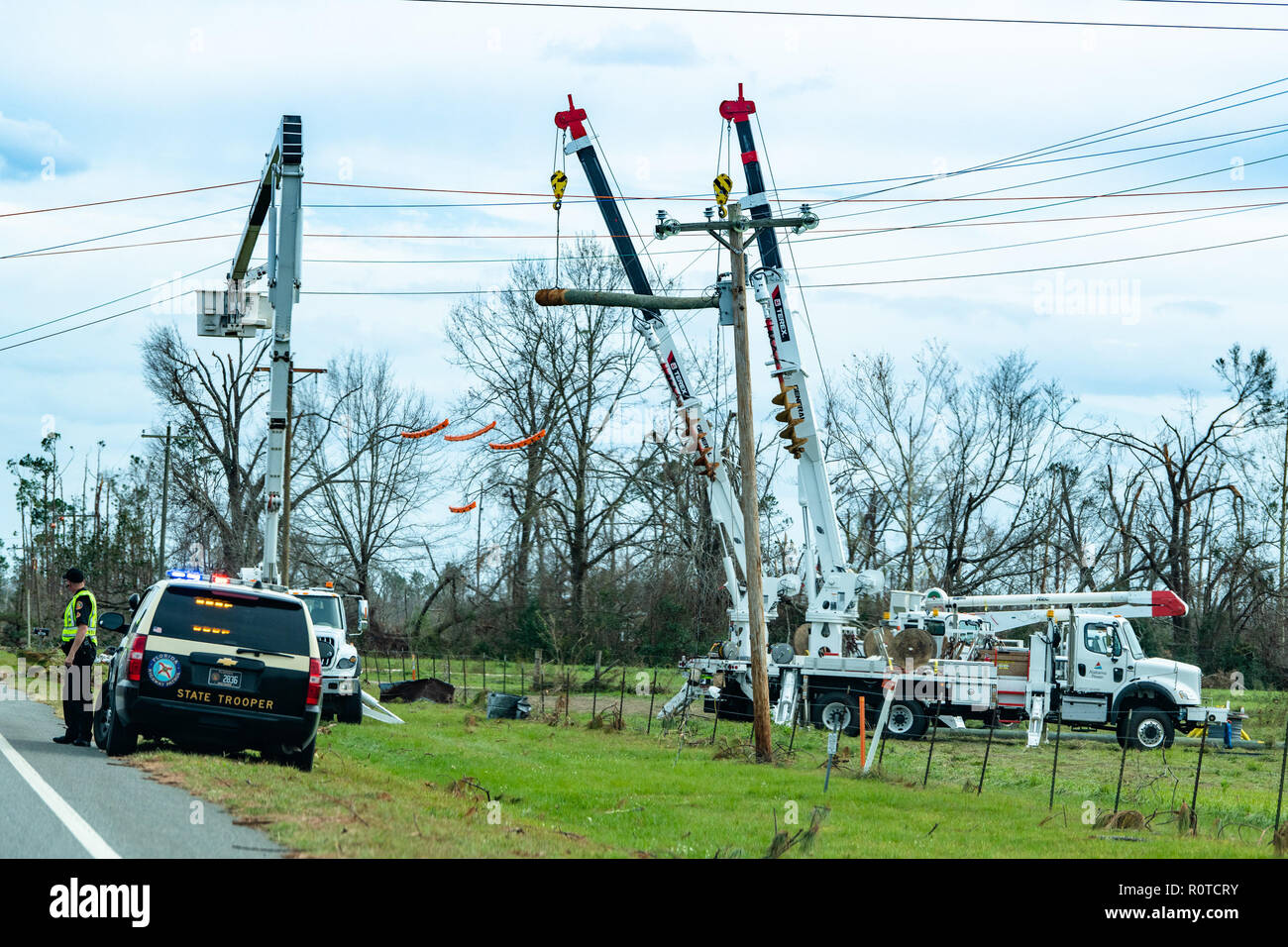 Altha, FL., Oct. 22, 2018--Linesmen work to restore power in the Florida Panhandle after Hurricane Michael struck on October 10, as a Category 4 hurricane, packing 155 mph winds. FEMA/K.C. Wilsey Stock Photo