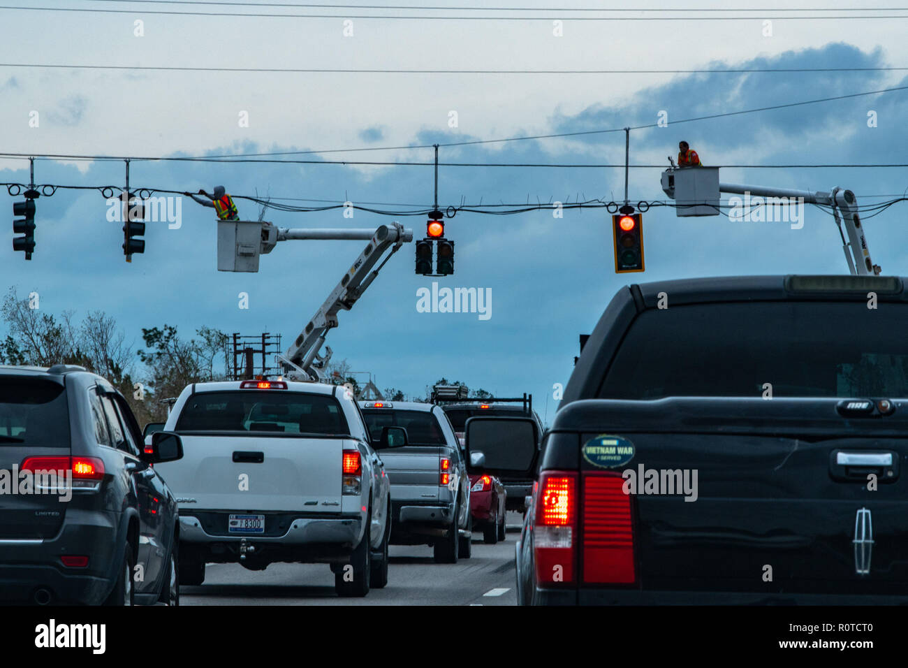 Panama City, FL., Nov. 2, 2018--Utility workers restore power to traffic lights in the Florida Panhandle after Hurricane Michael struck on October 10, as a Category 4 hurricane, packing 155 mph winds. FEMA/K.C. Wilsey Stock Photo