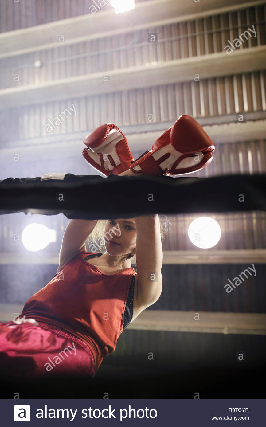 Tough female boxer in boxing ring - Stock Image