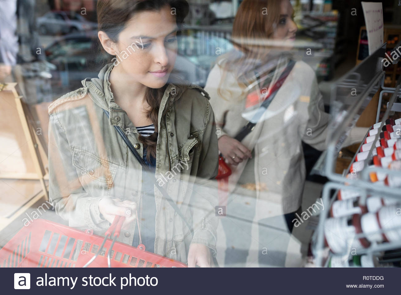 Woman shopping in art supply shop - Stock Image