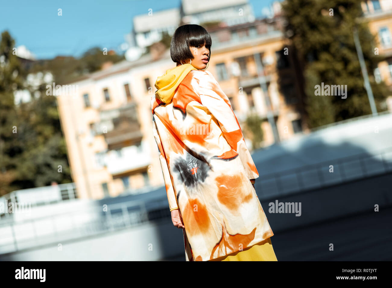 Young appealing lady wearing flower printed cloak - Stock Image