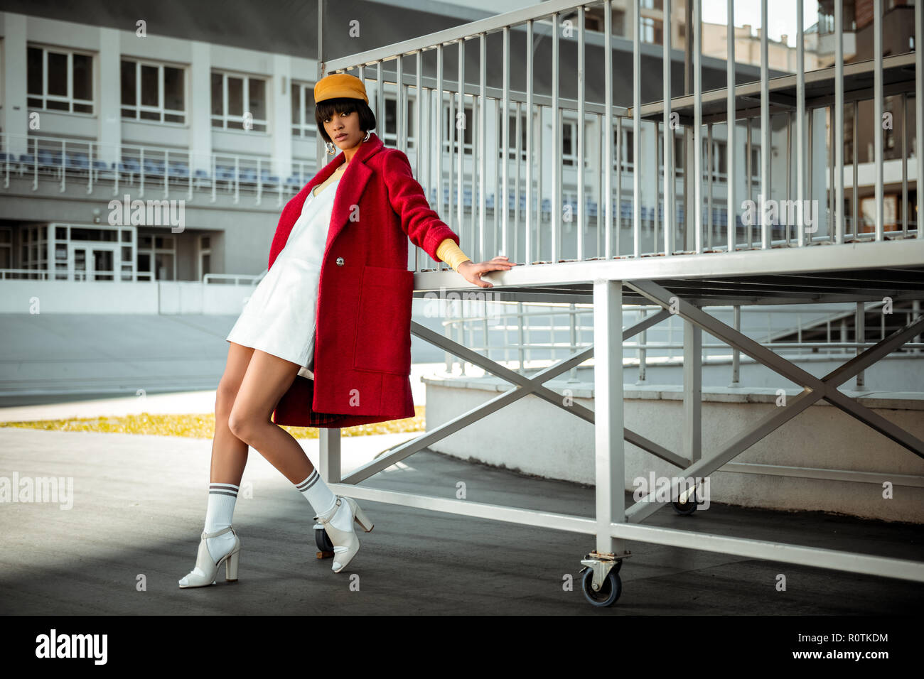 Remarkable fit model leaning on metal platform - Stock Image