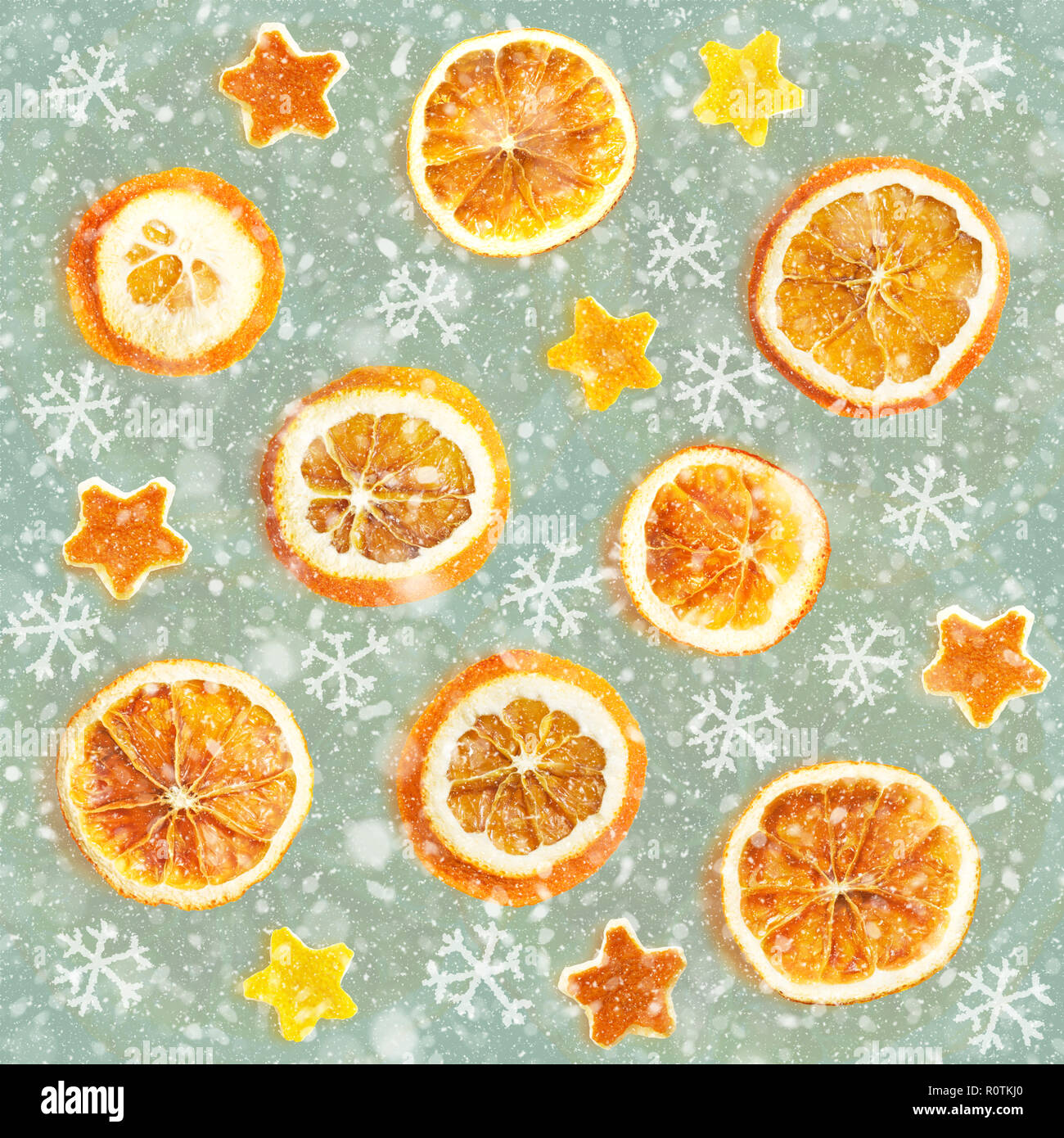 Christmas background of dried oranges, peel in the shape of a star. Seamless background - Stock Image