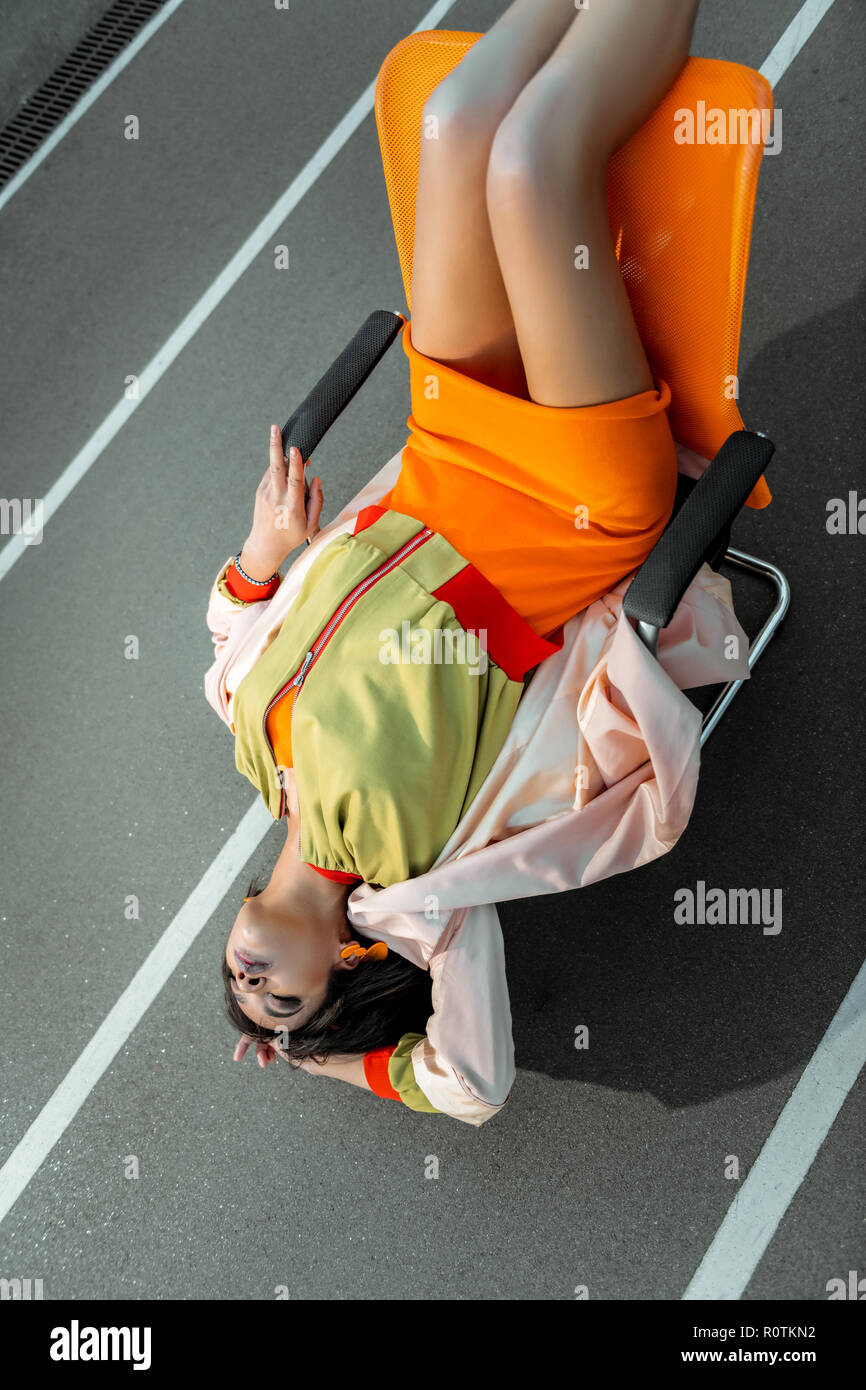 Interesting abnormal girl arching her body while lying - Stock Image