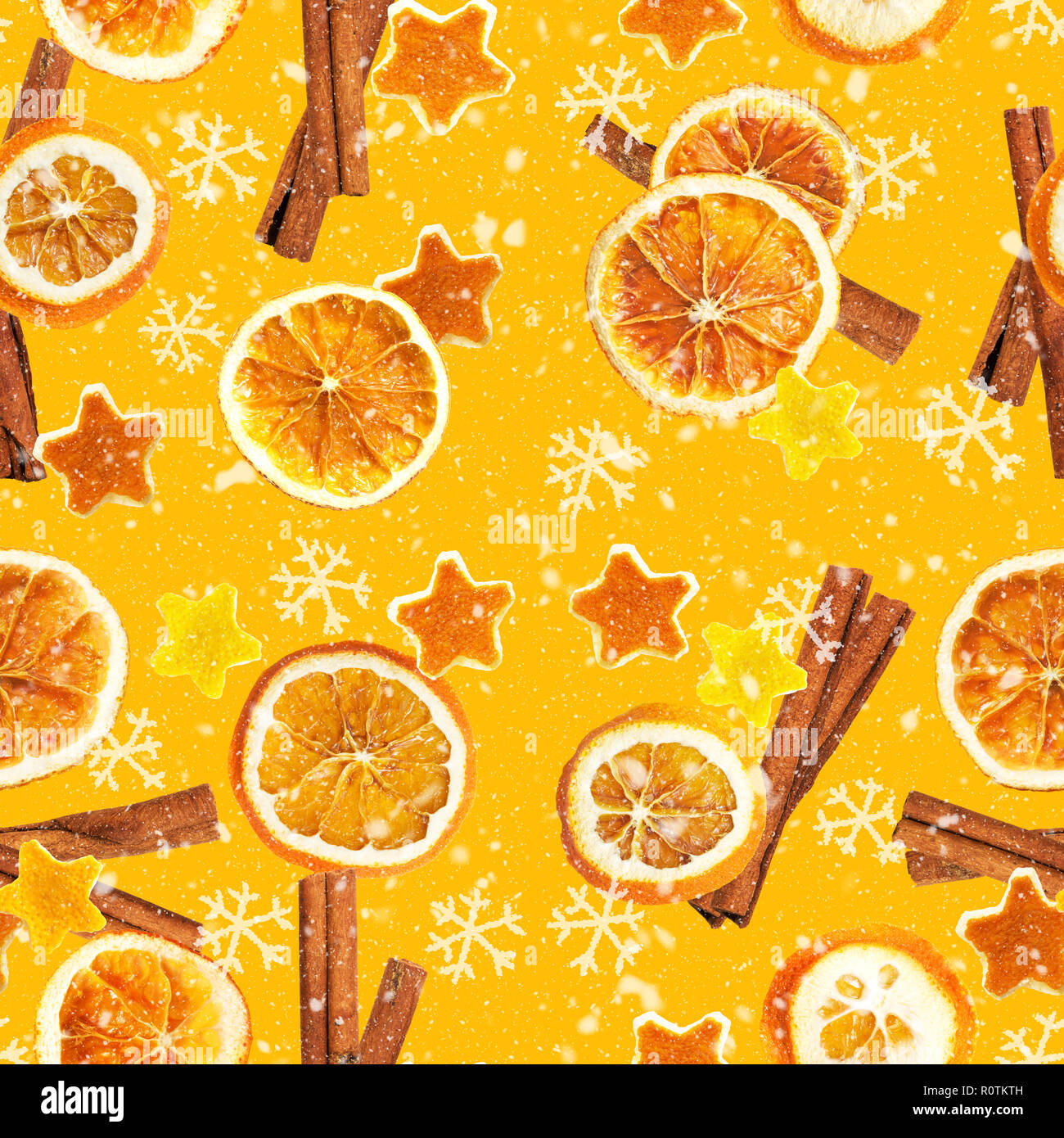 Christmas background of dried oranges, peel in the shape of a star and with cinnamon. Seamless background - Stock Image