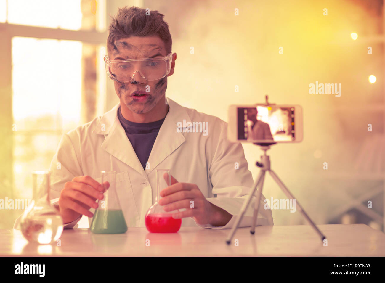 Disappointed blond guy wondering about experiment results - Stock Image