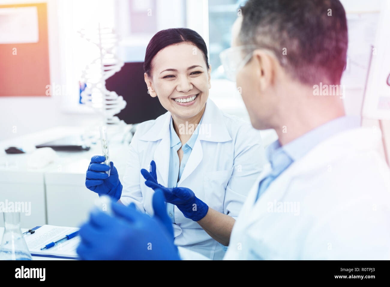 Happy nice smart scientists making new discoveries Stock Photo