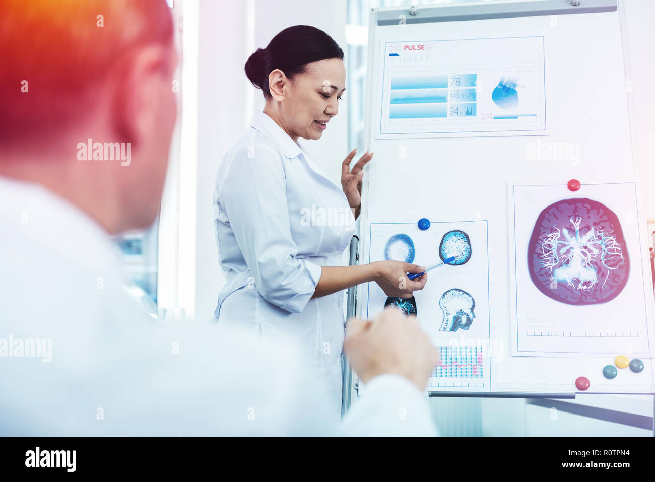 Intelligent smart woman explaining the structure of the brain - Stock Image
