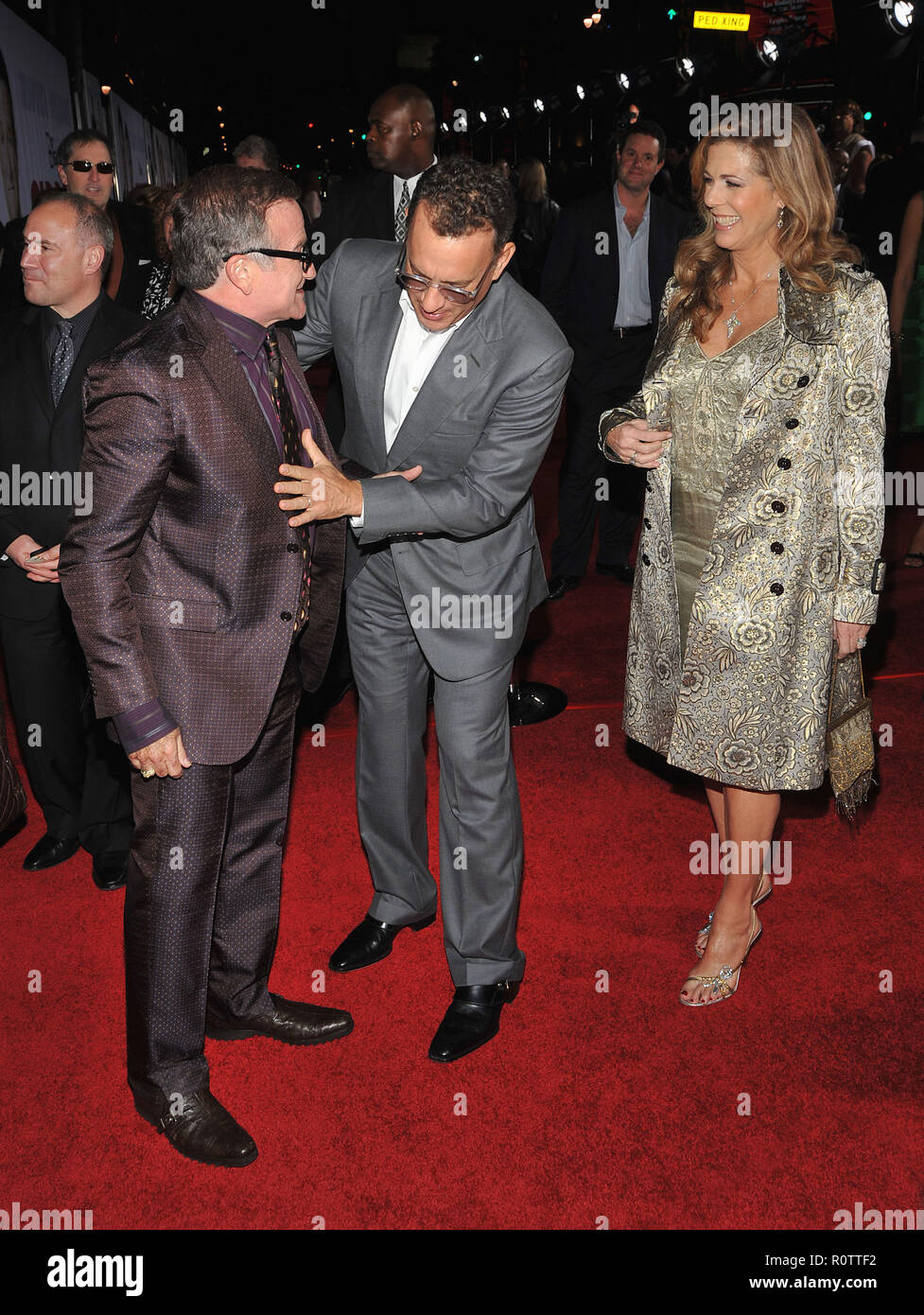 Robin Williams With John Travolta And Kelly Preston Checking The Belly Old Dogs Premiere At The El Capitan Theatre In Los Angeles Stock Photo Alamy