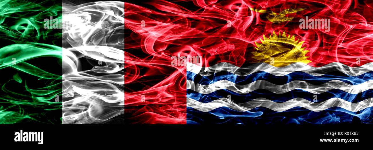 Italy vs Kiribati smoke flags placed side by side. Thick abstract colored silky smoke flags - Stock Image
