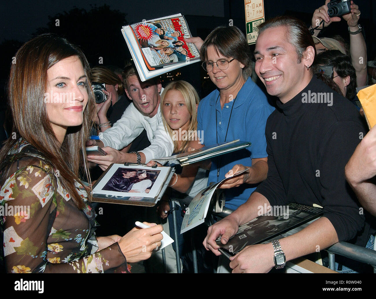 Courteney Cox-Arquette signing autograph at the premiere of ' Serving Sara  ' at the