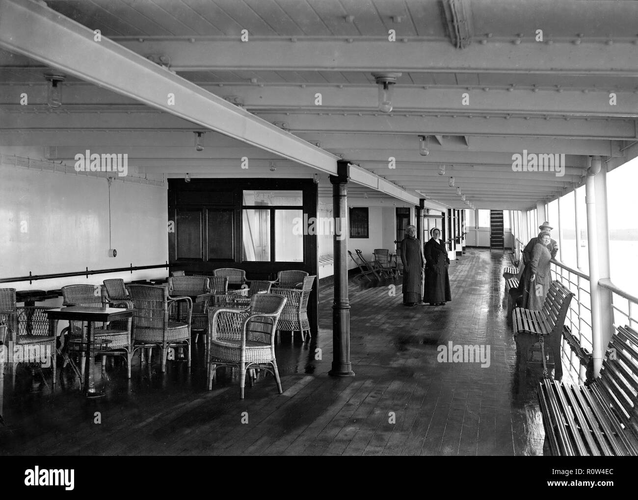 Promenade deck on 'SS Insulinde', 1914. The Dutch steam ship 'SS Insulinde' was built in 1914 for the Rotterdam Lloyd company and served as a passenger freight ship between Rotterdam and Jakarta. She was laid up during WWI and sold to the Fabre Lines of Marseilles in 1933. Renamed 'Banfora', she ran routes from Marseilles to West Africa. In WWII she served as a British troop and supply transport. - Stock Image