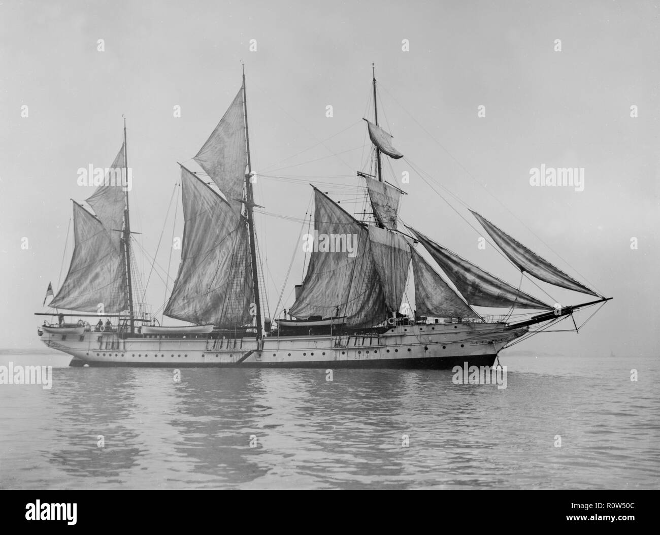 The steam yacht 'Wanderer' (later named 'Vagus') hoisting sails. Built by Robert Steele and Co, Greenock in 1878 for Charles Joseph Lambert as a private yacht, Wanderer was described as the most luxurious private steam yacht ever built. She was registered with the Royal Yacht Squadron and became known as 'RYS Wanderer', based at Cowes, Isle of Wight. In 1903 she was acquired by the Royal Navy and renamed 'HMS Sealark'. - Stock Image