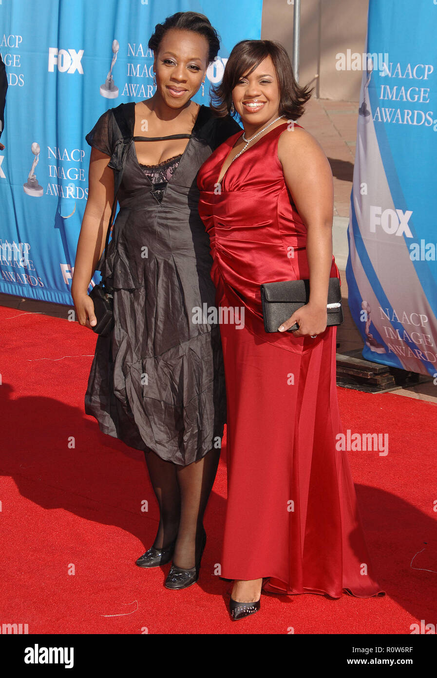 Marianne Jean-Bathiste and Chandra Wilson  at the 38th NAACP Awards 2007 at the Shrine Auditorium In Los Angeles.  full length eye contact smile red d - Stock Image