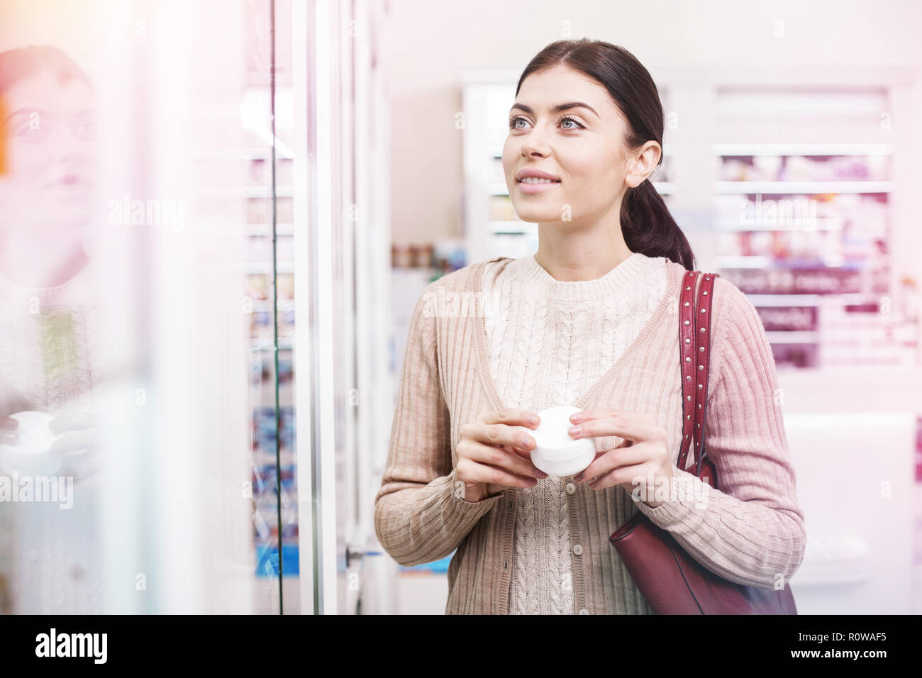 Customer searching for wished item in a store - Stock Image