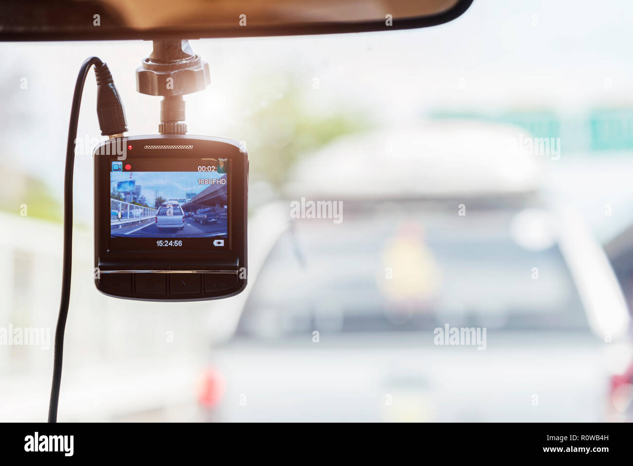 Recorder camera in front of car for safety on the road. - Stock Image