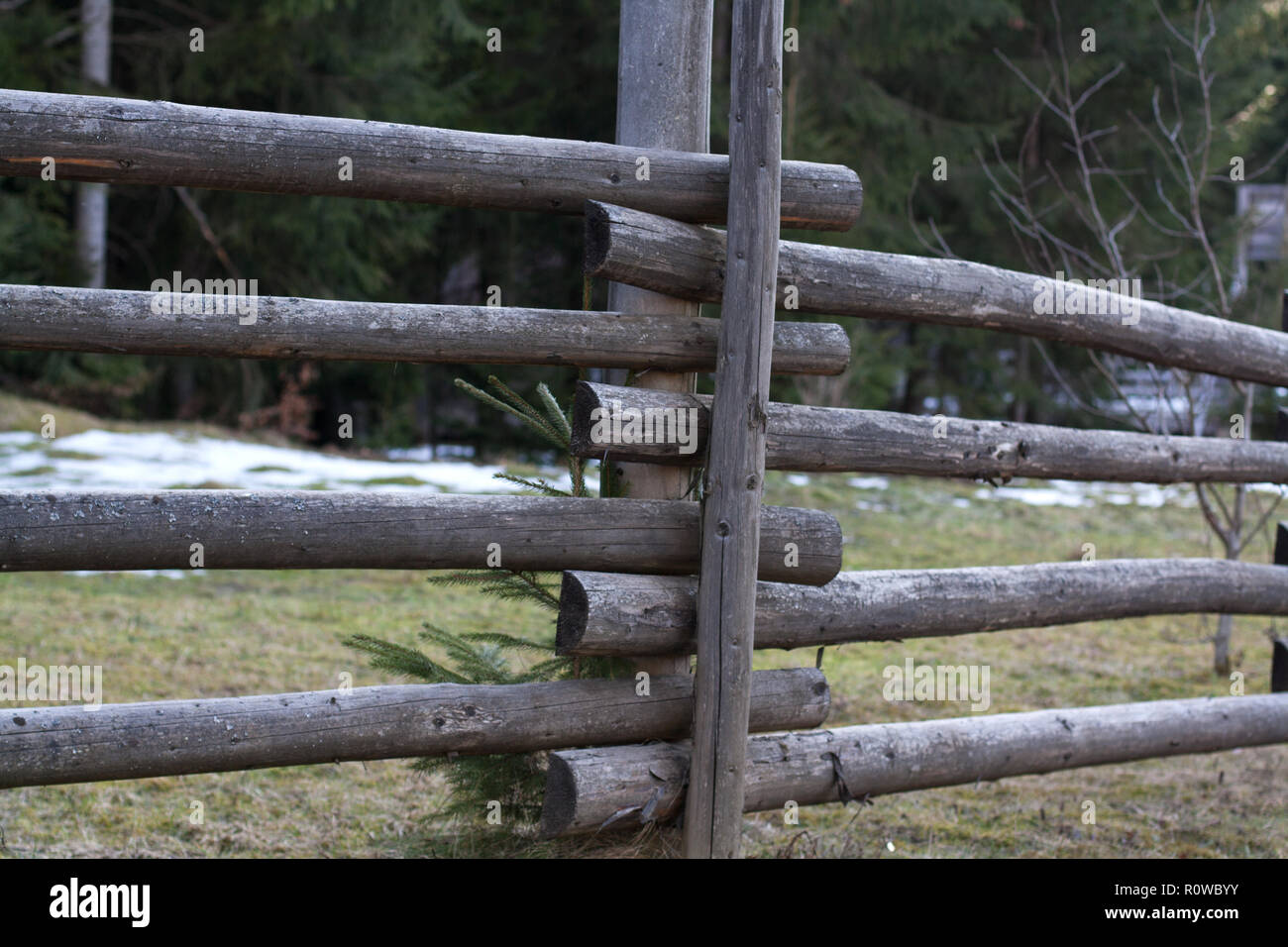 Wooden fence detail in mountains forest village on spring day - Stock Image