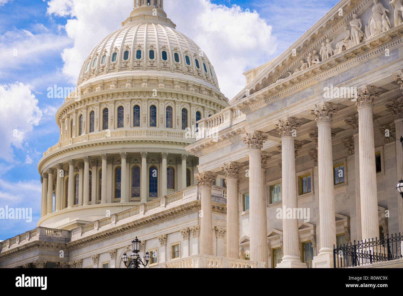 Sunny close-up view of the architectural detail of the neo-classical facade of the US Capitol Building under bright sky in Washington DC, USA - Stock Image